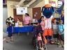 "Mets mascot Klutch visits kids at the Kids at Hope table during ""Sundaes at the Park""."