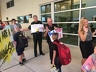 Port St. Lucie Police Chief John Bolduc and Chief Deputy of the St. Lucie County Sheriff's Office Garry Wilson welcome students on their first day of school with a Tunnel of Hope at Allapattah Flats.